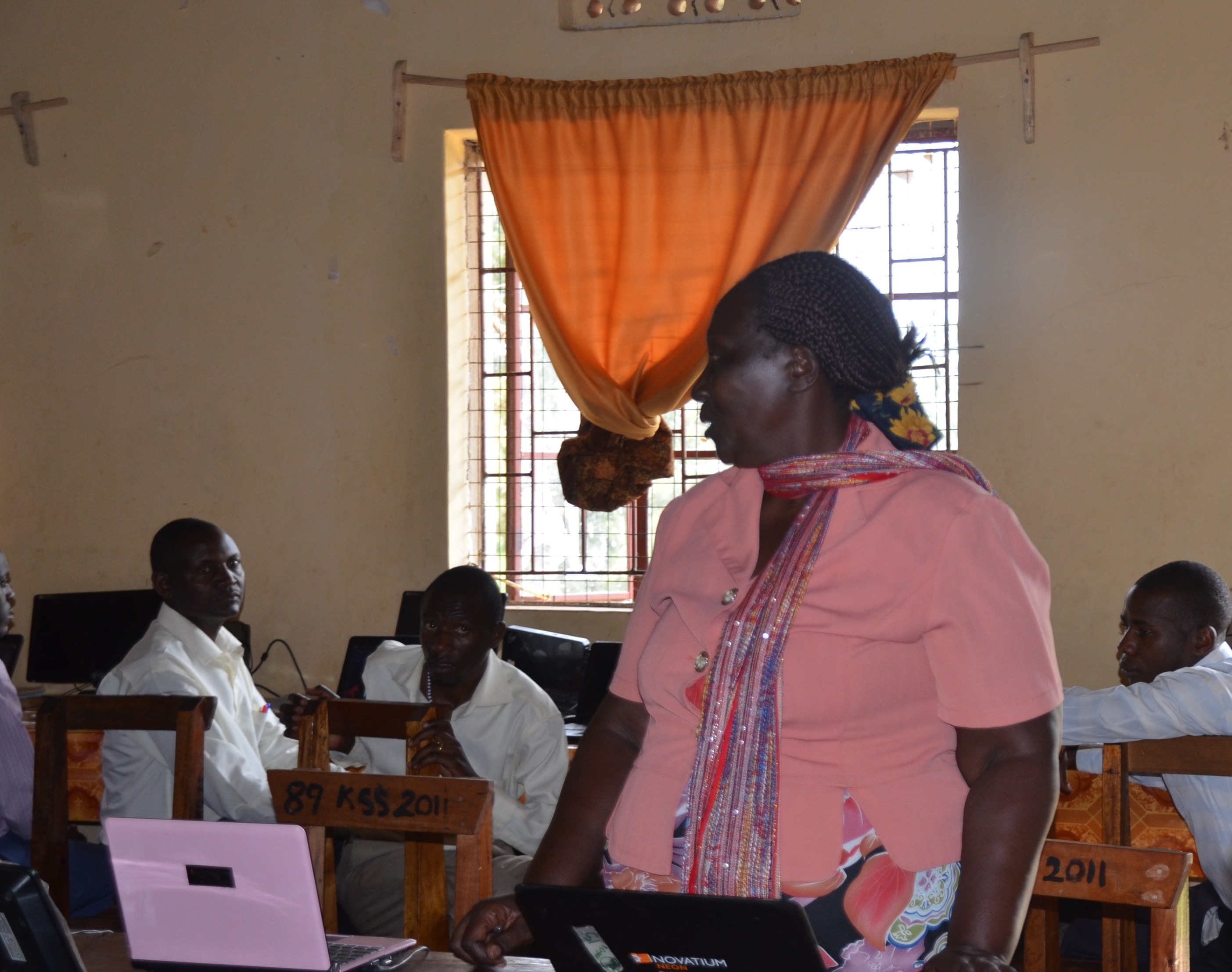 Kisyoro Headmaster Agrace Mugizi speaks to teachers during an ICT Integration workshop
