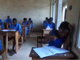Ramatu focusing during her secondary school completion exams